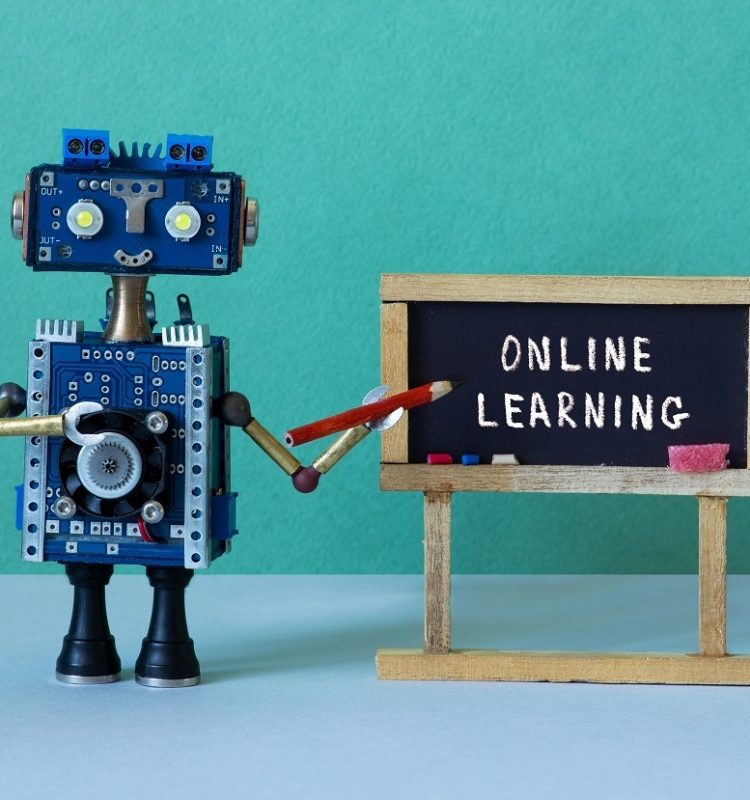 Online learning and distance education concept. Abstract interior classroom. Black chalkboard with handwritten text Online Learning. Robot teacher with a pencil pointer